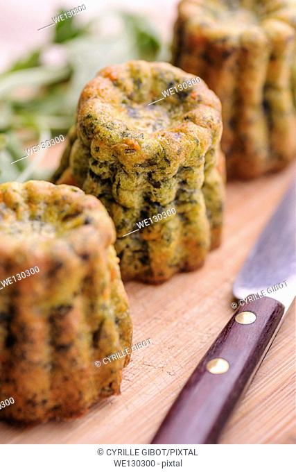 Spinach and salmon canneles, a variation of the traditional cannele recipe from Bordeaux, France
