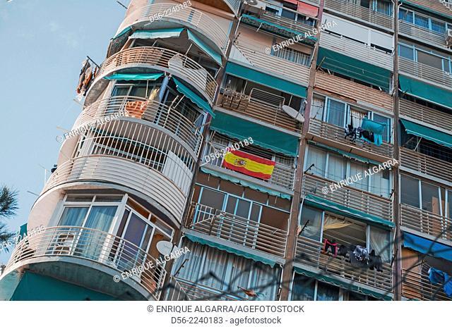 Apartments and spanish flag, Benidorm, Alicante province, Spain