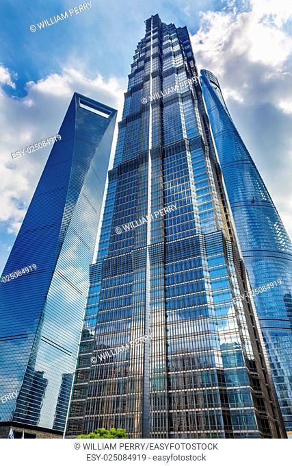 Jin Mao Tower Three Skyscrapers Reflections Make Patterns and Designs Liujiashui Financial District Shanghai China. Shanghai Tower andShanghai World Financial...