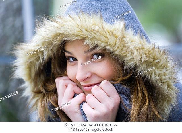 Shy teen girl warm under the hood