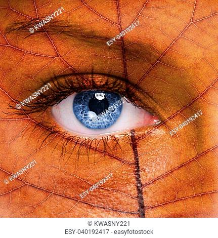 Woman face with autumn leaf texture
