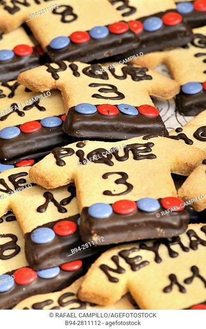 Cookies for sale shaped like a t-shirt. Names of Football players of Barcelona Football club, Piqué and Neymar. Sant Josep market, aka La Boqueria