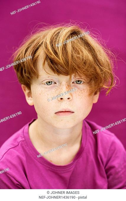 Studio shot of redhead boy