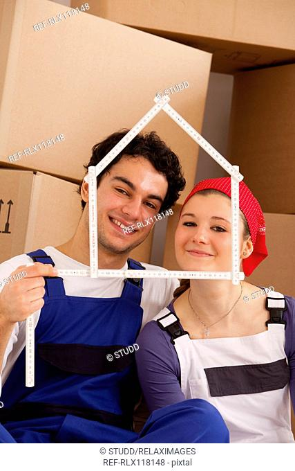 couple young moving in new home house frame ruler