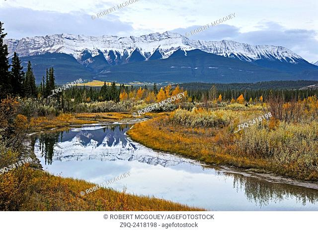 This landscape image of the snow-capped rocky mountains was captured one cloudy autumn morning in Jasper National Park, Alberta. Canada