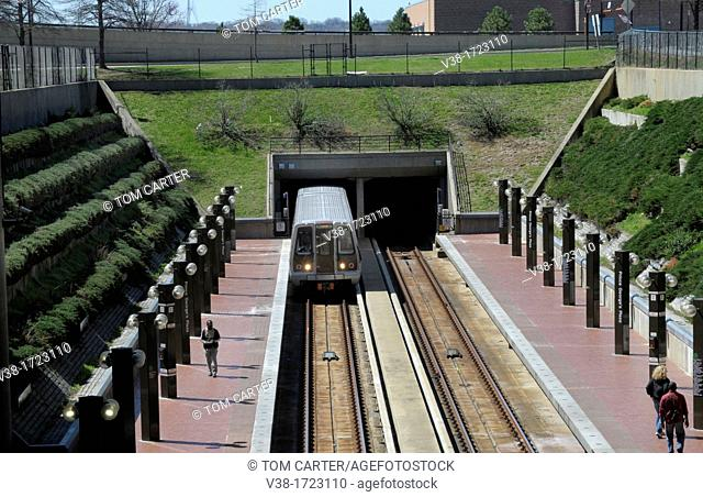 Metro subway train emerges from a tunnel at the Prince George's Plaza metro station in Hyattsville, Maryland