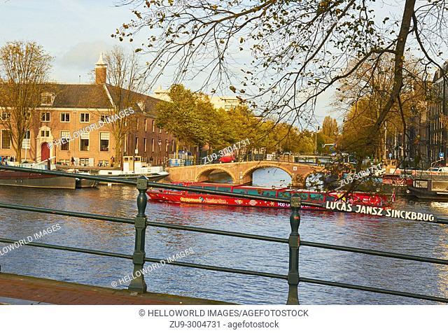 View from Lucas Jansz Sinckbrug bridge across the Amstel river towards Dirk Van Nimwegenbrug bridge and Nieuwe Keizersgracht, Amsterdam, Netherlands