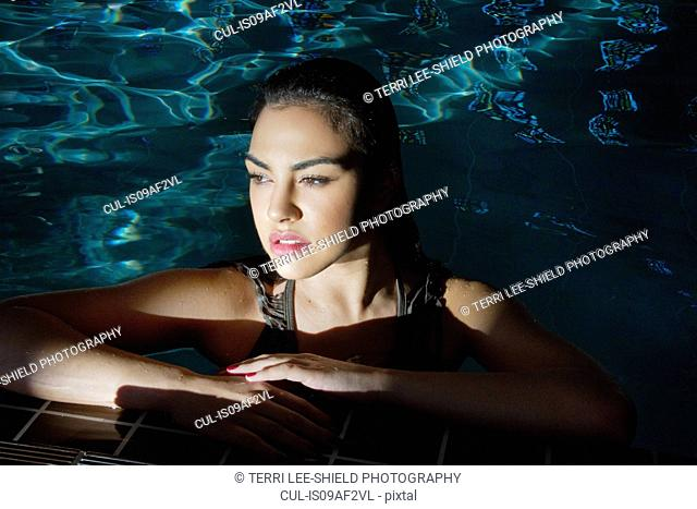 Young woman gazing from spa swimming pool