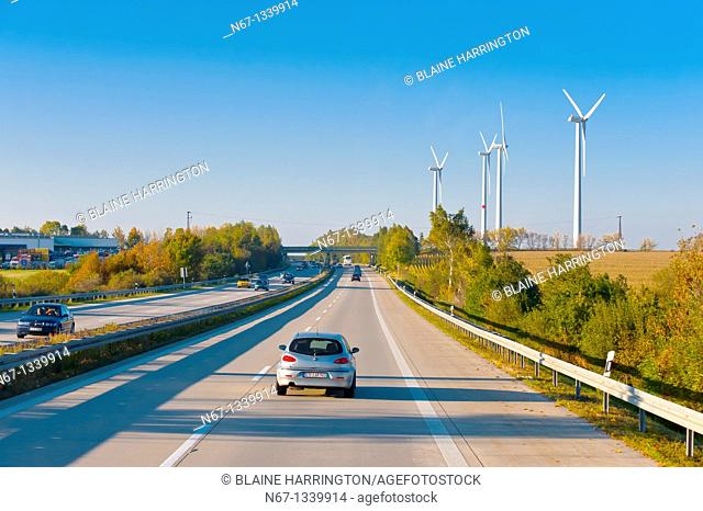 Wind turbines along an autobahn highway near Leipzig, Saxony, Germany