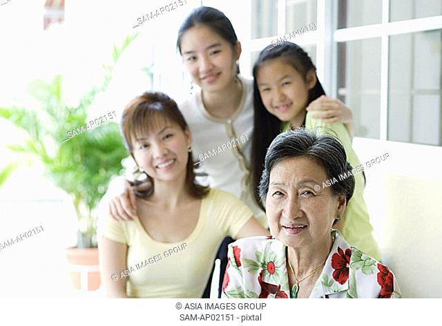 Three generations of females, looking at camera