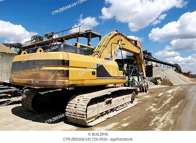 Large caterpillar excavator at Day Aggregates, a construction materials and recycling plant, Greenwich, South-East London, UK