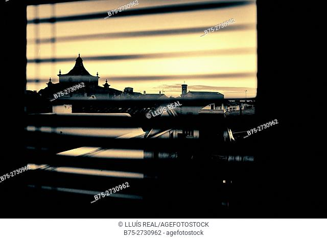 Bell towers of the Santa Maria and Carme churches, seen through window blinds. Mahó, Minorca, Balearic Islands, Spain