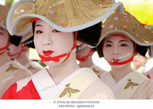Women in traditional costume at Hanagasa Junko (procession of floral bonnets) during Gion Matsuri traditional Japanese festival. Kyoto. Japan