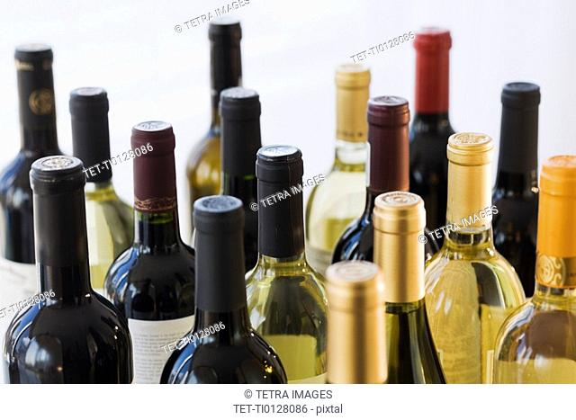 Close up of assorted wine bottles