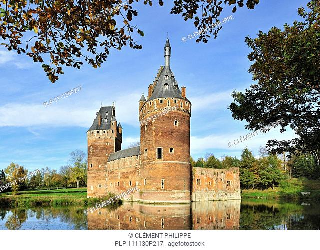 The medieval Beersel Castle surrounded by a moat, Belgium