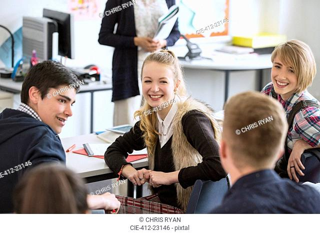 High School students sitting and smiling in classroom