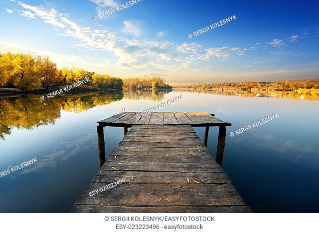 Bridge for fishing in sunny autumn day