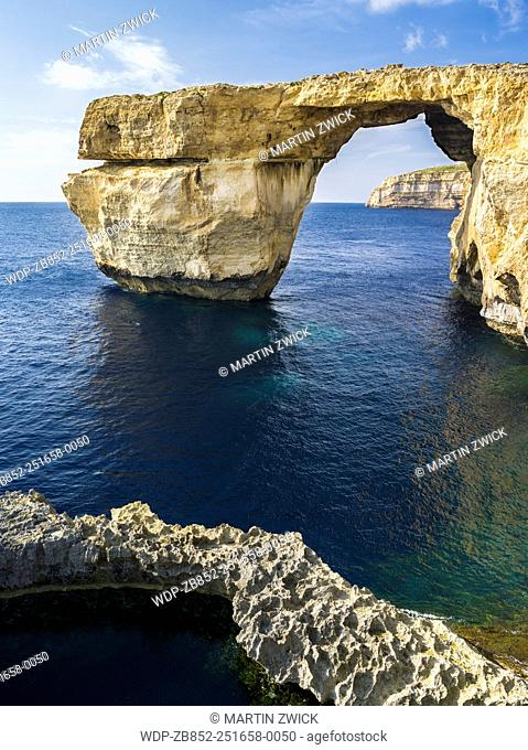 The island of Gozo in the maltese archipelago. Azure Window, an iconic natural arch or sea bridge at the coast of Gozo Europe, Southern Europe, Malta, April