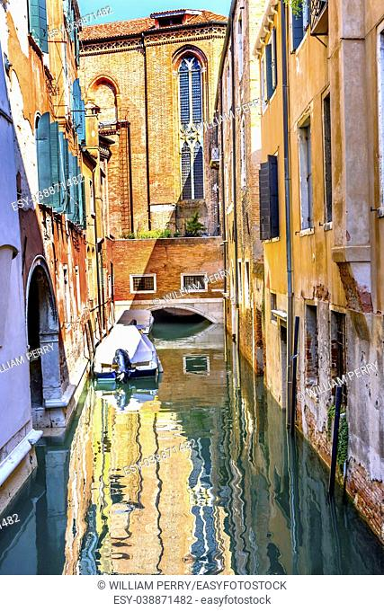 Motor Boat Colorful Small Side Canal Church Buildings Reflections Venice Italy
