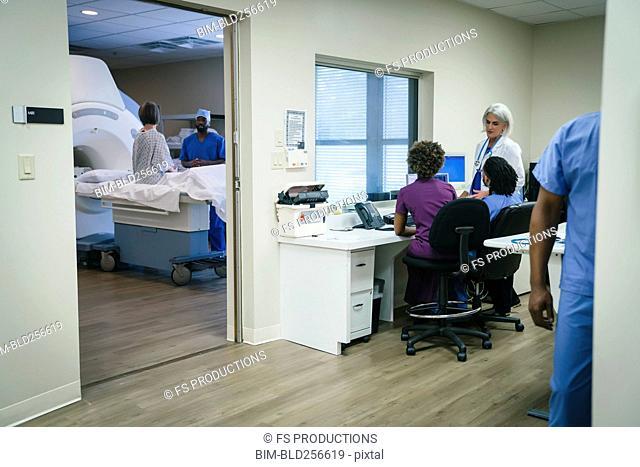 Doctors and nurses near scanner