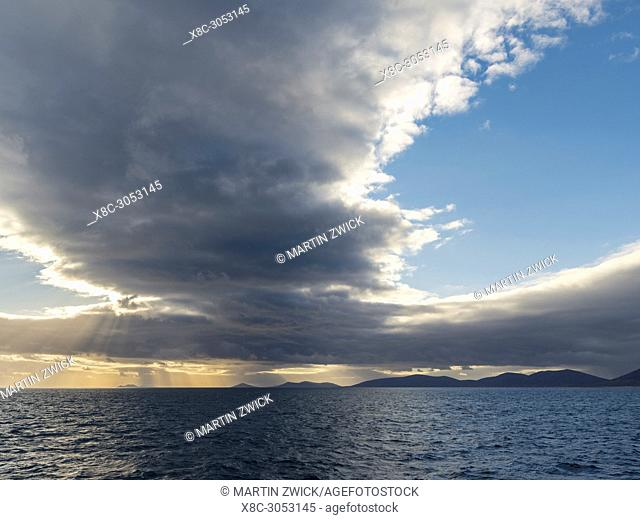 The islands of the West Falklands seen from the sea with dramatic clouds. Saunders Island, Keppel Island and Pebble Island