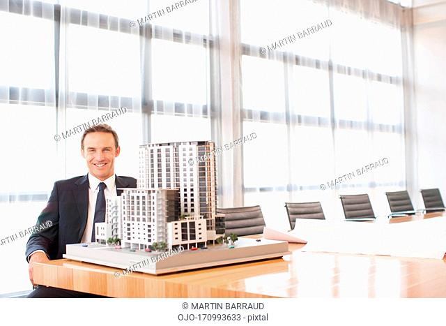 Businessman in conference room with model building