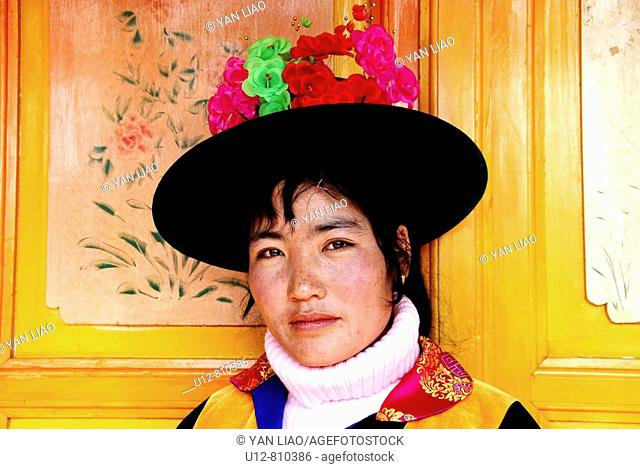 A Tu minority wearing Traditional costume in chinese new year(Pinyin call:Chun Jie,Spring Festival
