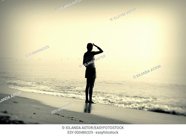 Young woman looking out to sea in winter  Mediterranean Sea