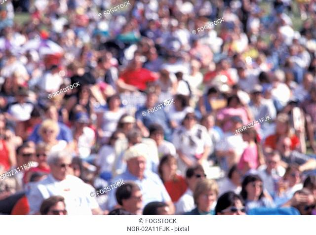 Crowd of People in the Sun