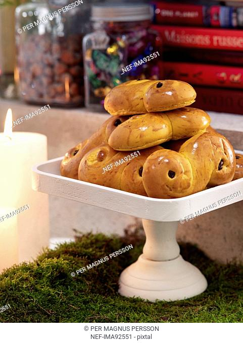 Saffron rolls on dessert stand, close-up