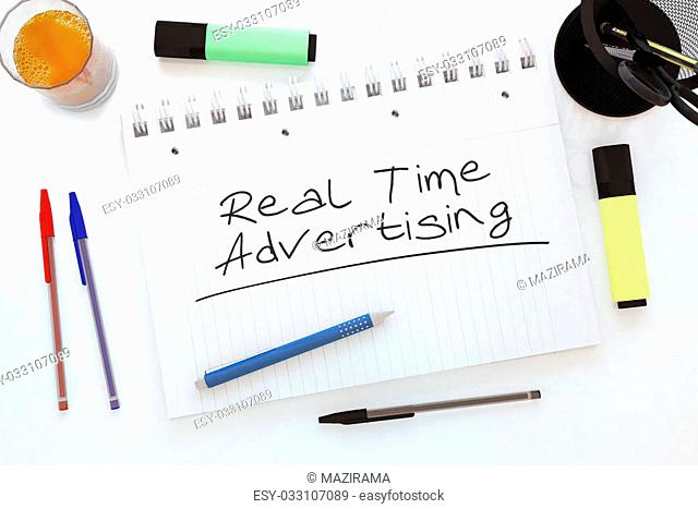Real Time Advertising - handwritten text in a notebook on a desk - 3d render illustration