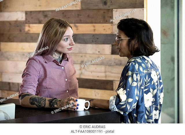 Women chatting during coffee break