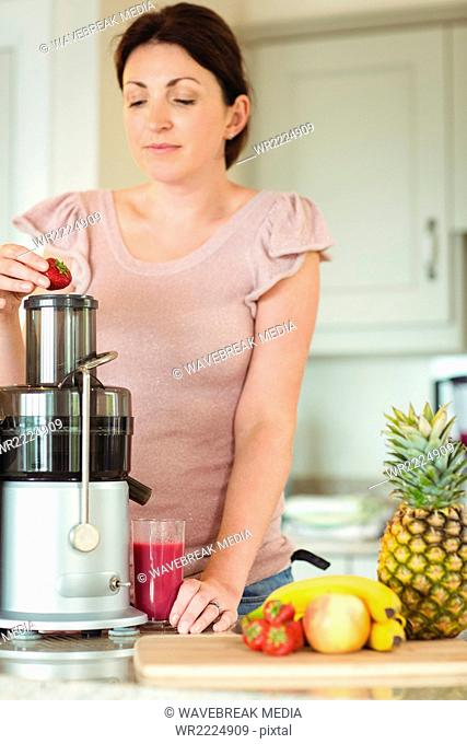 Woman preparing smoothie