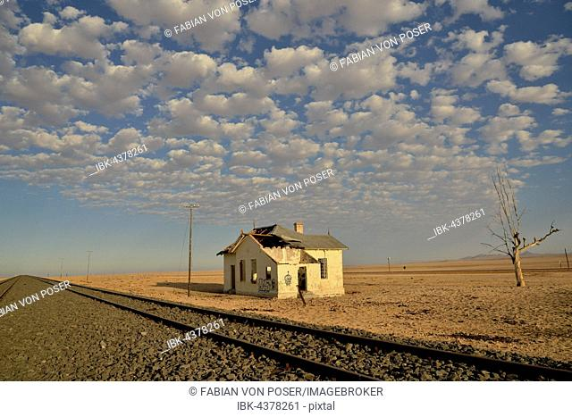 Derelict house by railroad tracks, former German railway station of Garub, Aus, Karas Region, Namibia
