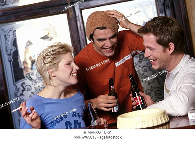 young people drinking a beer and smoking