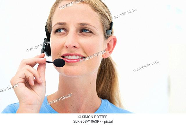 Woman with headset in bright office