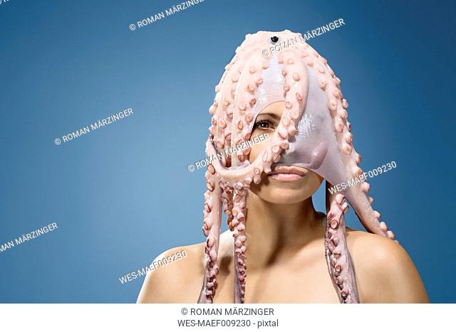 Portrait of woman wearing octopus headdress