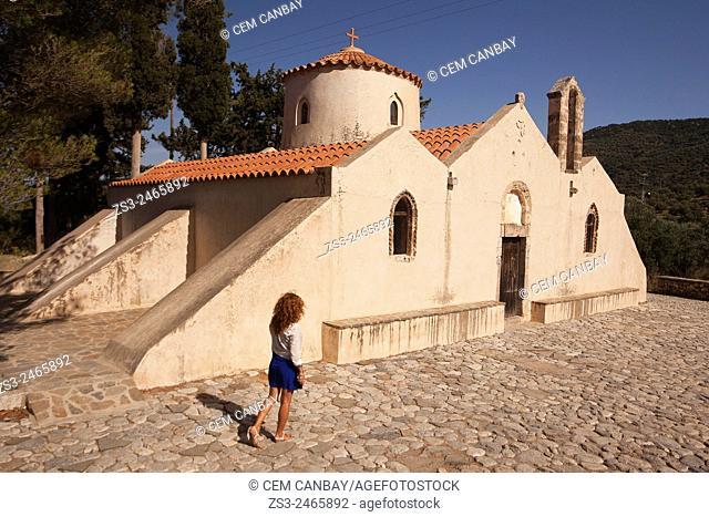 Woman in front of the Panagia Kera Church near Kritsa town, Lasithi Region, Crete, Greek Islands, Greece, Europe