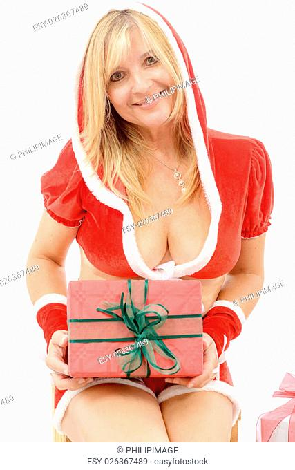 beautiful Santa woman holding a gift box