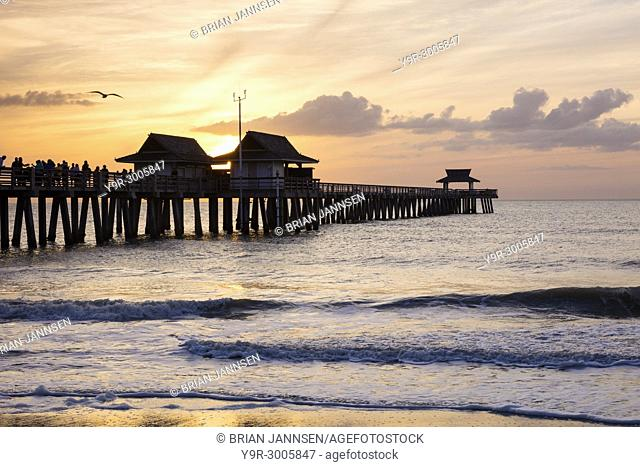 Moody evening over the Fishing Pier and Gulf Coast at Naples, Florida, USA