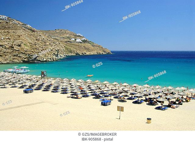 Lined-up sunshades on Super Paradise Beach, Mykonos, Cyclades, Greece, Europe