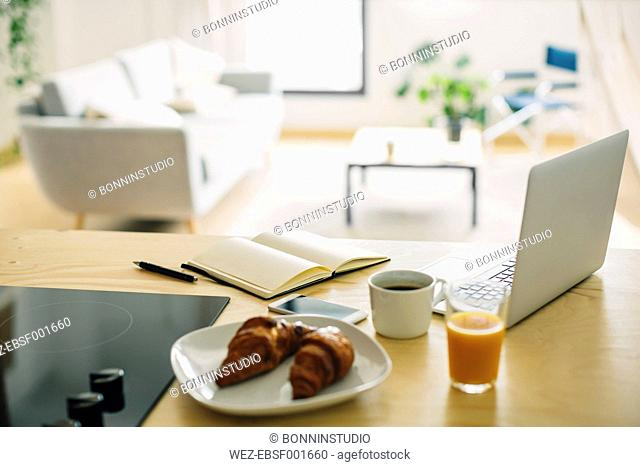 Home office and breakfast on the kitchen counter