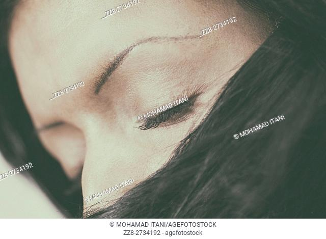 Woman eyes closed hair covering face