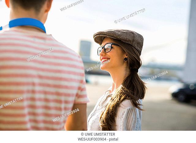 Smiling young woman looking at man