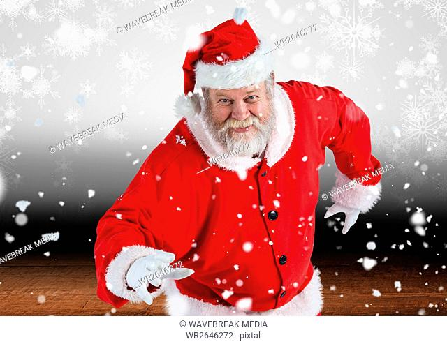 Santa claus posing in snow fall