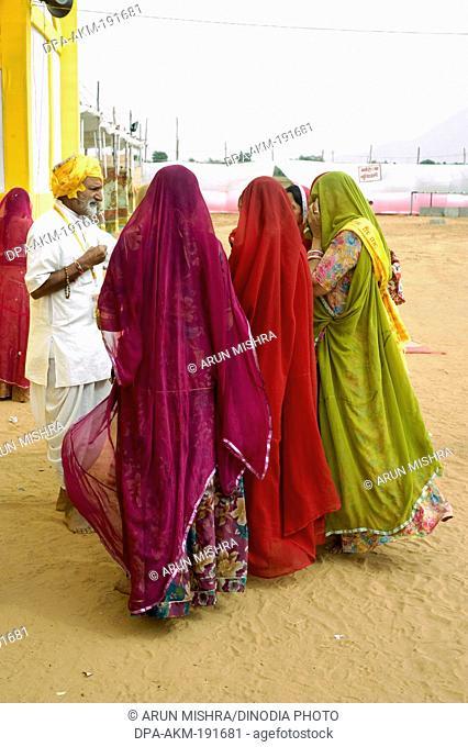 women talking with priest pathmeda godham rajasthan