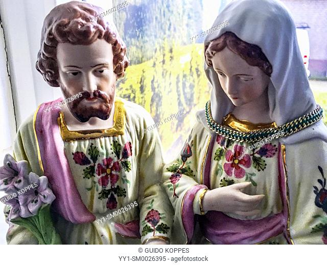 Dongen, Netherlands. Statue of Saint Joseph and Mother Maria near the kitchen window inside a religious household