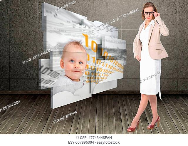 Severe pretty businesswoman looking at camera against dark room with floorboards