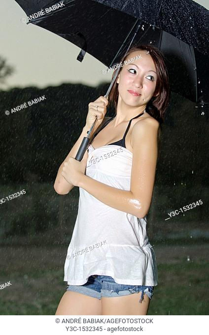 Asian girl in the rain