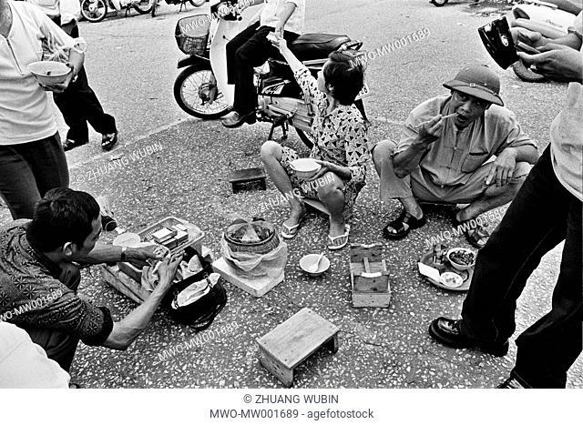Grabbing a bite outside Hanoi train station